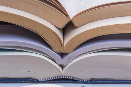 Open books stack close up on white desk 版權商用圖片