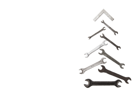 christmas tree figure made of old dirty rusty vintage wrench tools isolated on white background with copyspace 写真素材
