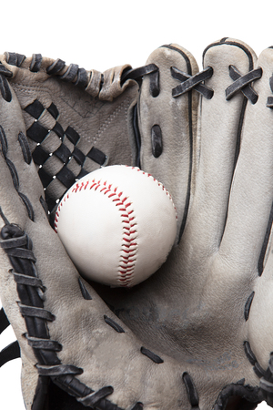old used baseball glove and ball isolated on white closeup