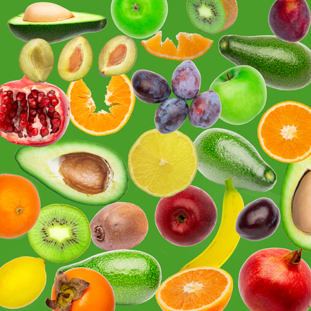 Creative flat layout pattern collage of fruit, top view. avocado, orange, lemon, plum, banana, pomegranate, apple isolated on green background. Food wallpaper, composition pattern of fresh fruits.
