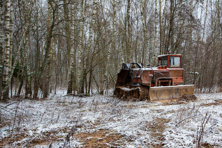 Rusty abandoned caterpillar snow tractor on winter surrounding, russia Stock fotó