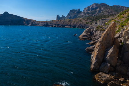 Dramatic landscape of rocky coastline and turquois water and blue sky, Crimea, Ukraine