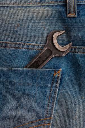 Wrenches tools in blue jeans pocket closeup Stock fotó