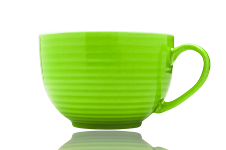 green clean porcelain tea or coffee cup mug isolated on white with reflection under it on surface, front view