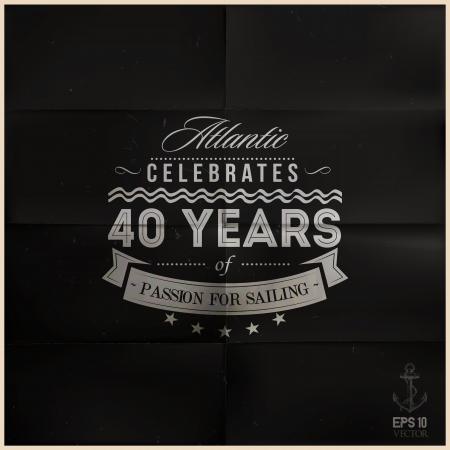 folded black sailing anniversary badge