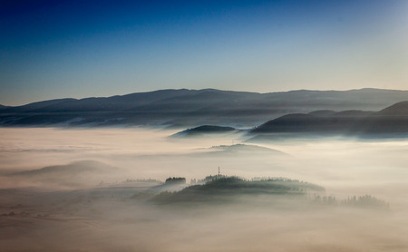 Above the clouds in a sunny day Stock Photo