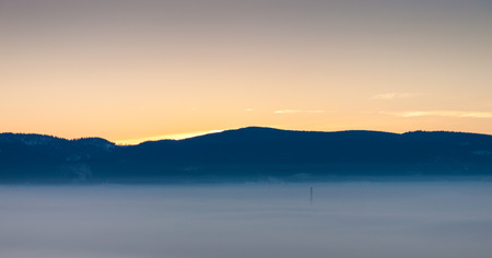 Cold and foggy winter dusk Stock Photo