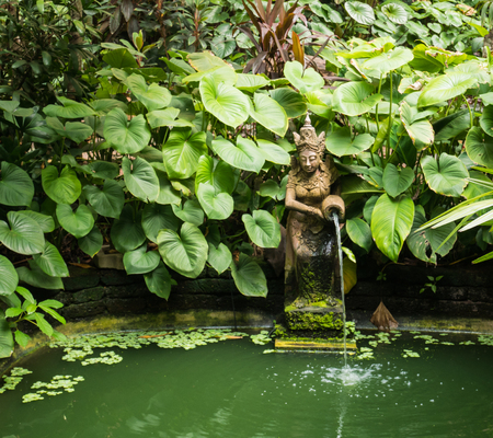 Pond with a woman sculpture in Thailand