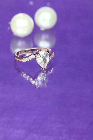 Diamond Ring with Pearls on Purple  photo