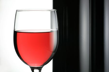 Wine Bottle with Wineglass on Whiter