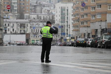 Kiev, Ukraine - November 29, 2017. Policeman regulates traffic at the crossroads in Kiev.