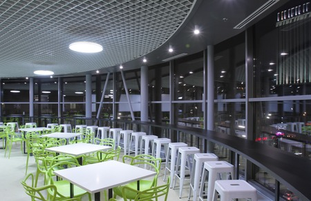 Interior of the dining room in the modern office of the business center.