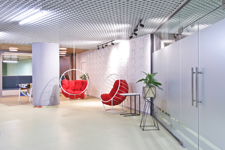 Lounge area in a modern office. Interior design. Outboard chair. Editorial