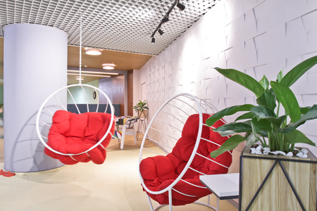 Lounge area in a modern office. Interior design. Outboard chair. Stock Photo