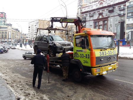 Kiev, March 6, 2018, Ukraine. The police evacuate the car from the roadway. Violation of traffic rules. Snow on the winter road.