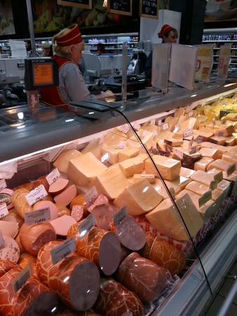 Kiev, March 6, 2018, Ukraine. Buyers in one of the supermarkets in Kiev buy cheese.
