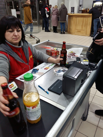 Kiev, March 6, 2018, Ukraine. The cashier in the store. The girl is calculated for the goods by credit card.