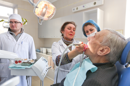 Kiev, December 26, 2017, Ukraine. Students of the medical university practice in the stomatological office of the University in Kiev. The dentist treats the patient.