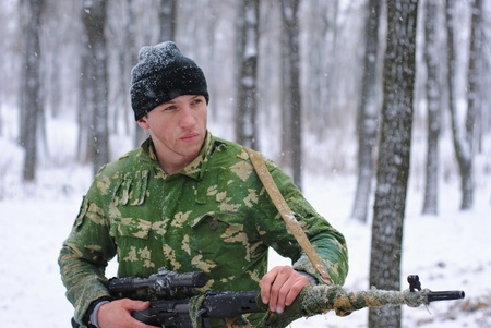 The soldier. The sniper. A sniper rifle. photo