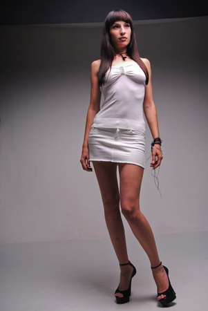 A girl is in white clothes. photo