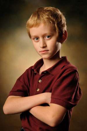 10 year old: Idly by conceived 10 year old boy watching attentively before itself Stock Photo