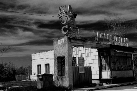 abandoned gas station: The photo shows an abandoned gas station  black and white photo was taken