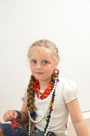 imitate: The photo shows a little girl, she tries to imitate adults and look fashionable and stylish. Stock Photo