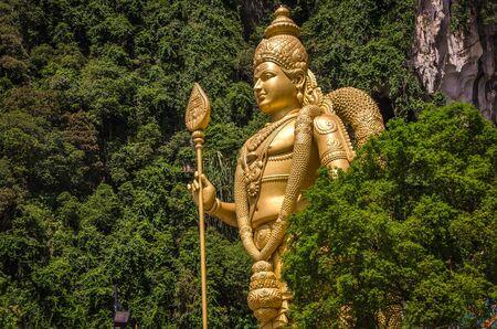 KUALA LAMPUR, MALAYSIA - DECEMBER 18, 2018: Lord Murugan's statue, Batu cave, Malaysia, dedicated to Tamil God Lord Murugan, Cave was built in 1920.