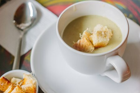 celery root: celery root cream soup with croutons and cheese