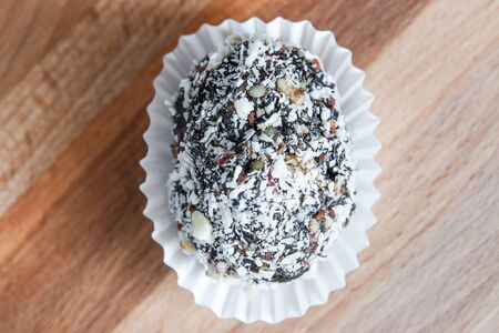 prune: Homemade candy with prune, peanut and coconut flakes