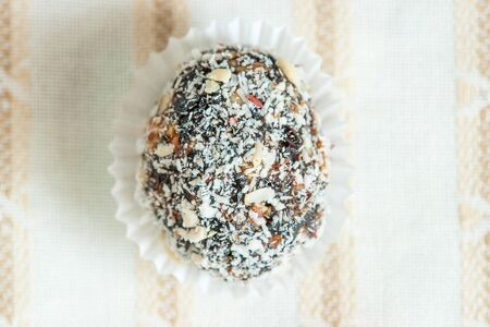 ciruela pasa: Homemade candy with prune, peanut and coconut flakes