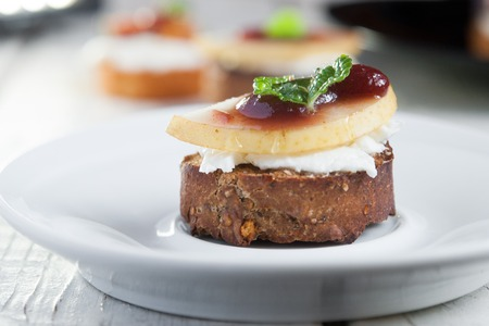 goat cheese: Bruschetta with goat cheese, pear and figs Foto de archivo