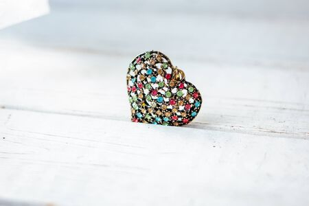 Valentines day background. Beautiful jewellery heart on wooden background. Stock Photo