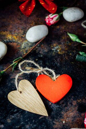 bounded: Two bounded hearts on rustic background