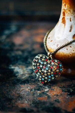 Valentines day concept - heart jewellery pendant on black background Stock Photo