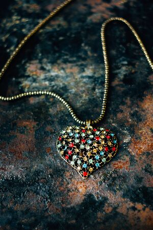 pendent: Beautiful heart made from metal and presicous stounes on black.
