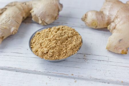 metalic: Grounded ginger root in metalic bowl on white surface. Stock Photo