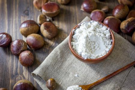 Natural organic chestnut flour in brown ceramic bowl