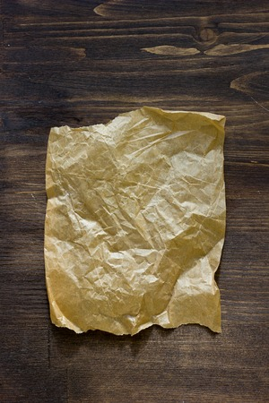 noteboard: List of parchment paper on brown wooden board Stock Photo