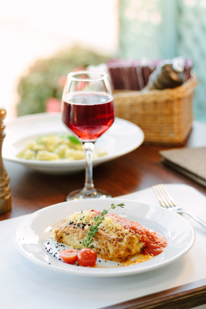 Lasagne in tomato sauce with red wine at italian food restaurant.