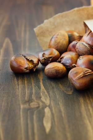 Roasted chestnuts in paper cornet Stock Photo