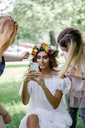 Beautiful bride making selfie during the make up session.