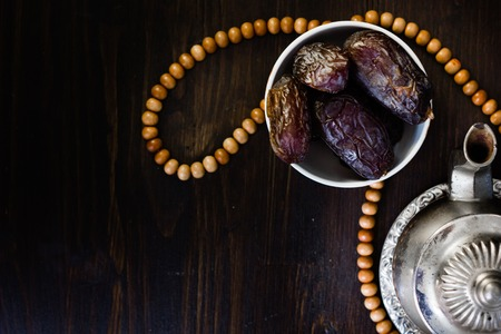 Top view of iftar fruit - dates and islamic rosary