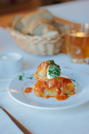 Delicious cabbage rolls on white plate in restaurant
