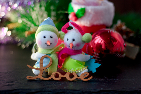 them: Pair of christmas snowmans with word Love near them Stock Photo