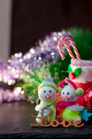 Pair of christmas snowmans with word Love near them Stock Photo