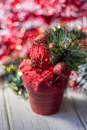 Artifical poinsettia - christmas symbol in red flower pot Stock Photo
