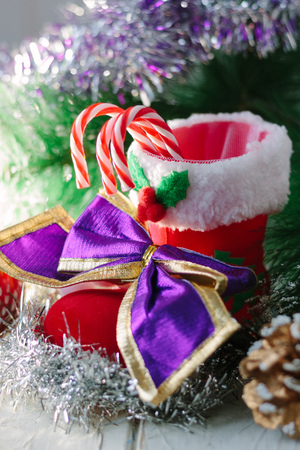 Christmas background - decoration with red boot or shoe, candy canes and other christmas attributes. Stock Photo