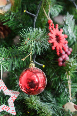 Red christmas ball on the christmas tree.