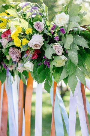 Close up view of flowers on wedding arch Stock Photo